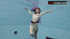 Smoking hot Russian redhead Ala in the pool
