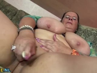 Mature Lady Oiling And Playing Her Tits