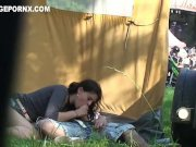 daring lovers banging behind tent near public function