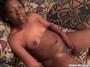 Ebony granny Amanda peels off her pantyhose