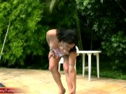 Black hair shedoll in miniskirt strips and teases poolside