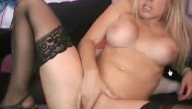 Busty babe masturbates and cums on cam