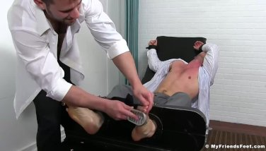 Hot fit business man gets feet tickled
