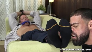 Muscular businessman Joey J bound by feet eating deviant
