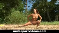 Sport sexy club Sexy redhead enjoys nude fitness at the beach