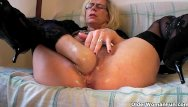 Mature older hairy Perverted granny fists her hairy pussy