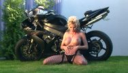 Asian motorcycle Busty blonde teases on a motorcycle in nylon