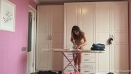 Breasts ironing in cameroon Ironing the kinky clothes while completely naked