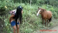 Pee asaians Hd peeing next to horse in jungle