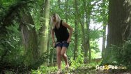 Gushing pee holes Blonde gushes piss while in the woods