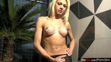 Blonde tranny in hot string bikini strokes