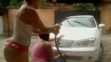 Two Busty Latina Girls Washing Car