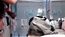 Spy cam catches cute brunette teen showering