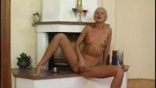 Pretty blonde pleasuring herself