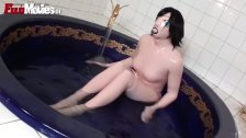 Girl on latex goes crazy rubbing her body