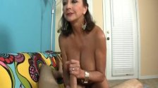 Busty Mature Lady Strokes A Cock