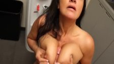 Naughty MILF in the kitchen