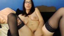 Horny glasses girl fucks her pussy