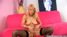 Blonde MILF in stockings is dildoing