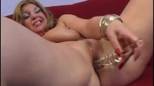 Hot MILF with big tits is dildoing