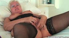 Chubby grandma in stockings rubs her clit