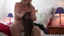 Grandma with big breasts rips open pantyhose