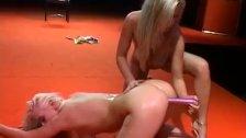blonde flexible lesbian orgasm on public show