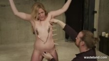 Her body is pinched and nipple clamped
