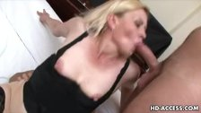 Blonde milf takes care of two guys