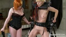 Ginger dominatrix plays with blondes pussy