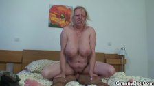 Moaning grandma rides young meat