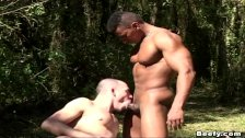 Muscle man seducing the black hunk friend