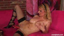 Young blonde Bonnie oils her big jugs