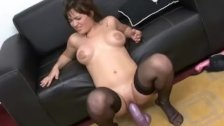 Thick broad in stockings rides a brutal dildo