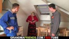 Two repairmen bang busty grandma