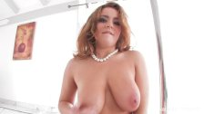 Natasha Nice is a sexy stripper in white
