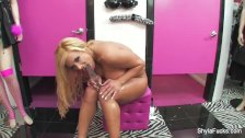 Shyla toys her pussy in a dressing room