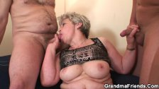 Grandma warms up before swallowing two cocks