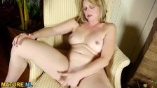 Blonde mature pleasuring herself with her han