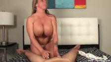 Huge-titted milf enjoys stroking cocks