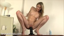 Amazing blonde riding a massive dildo
