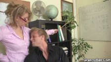 Office mature in white stockings riding him