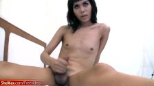 Tranny with pretty face wanks her hairy shecock and cums