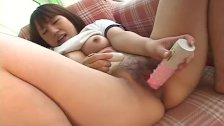 Cute Asian teen with a cute face toy fucks her pussy