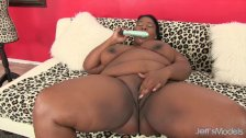 Chubby ebony beauty shoves a dildo in her fat pussy