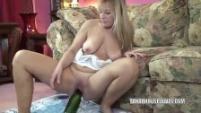 Liisa uses a huge bottle on her mature pussy