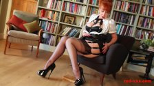 Hot and sexy MILF fingers her pussy in her private library