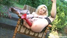 Anita Vixen stretches both her tight holes with a big dildo