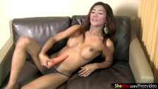Curvy ladyboy dances in tight jeans and fucks a carrot dildo