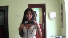 Sexy brunette Asian babe fools around with the camera